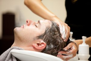 man getting hair loss treatment at focal point