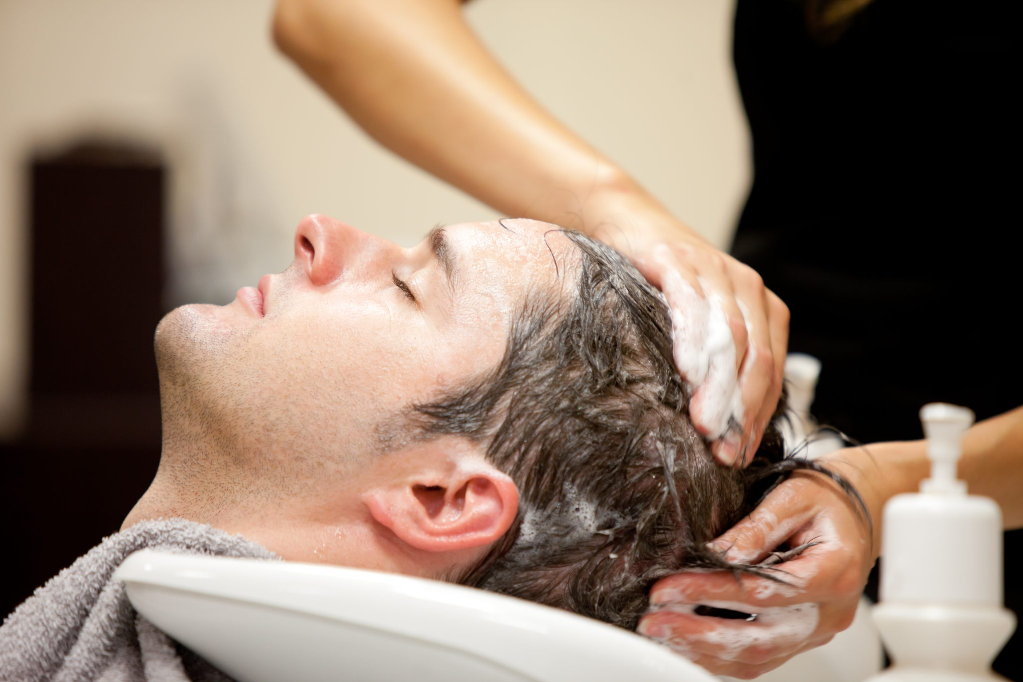 Man getting Head Spa for Hair Thinning Treatment at Focal Point