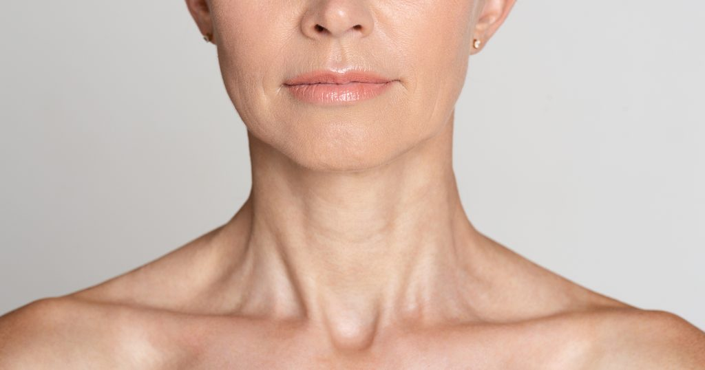 Skin care. Half face portrait of mature woman