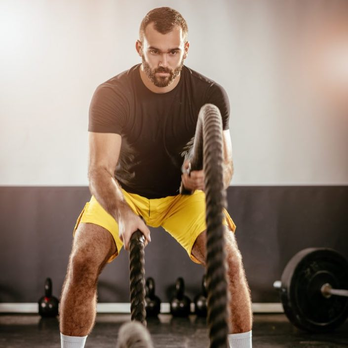 row-2-man-at-the-gym-with-ropes